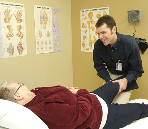 Physiotherapist works with a patient
